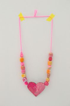 wooden beads painted with liquid watercolors + painted cardboard shapes