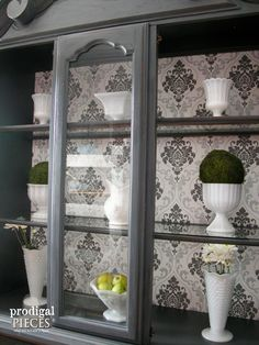 Want an easy way to update an outdated china cabinet? Seriously easy update with major impact by using wallpaper, and not just any wallpaper. Come see!