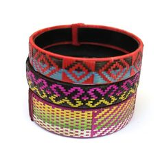 Handmade, fair trade, bright cana flecha cuffs, which feature contemporary, graphic designs in fun geometric and tribal patterns. Handmade in Colombia.