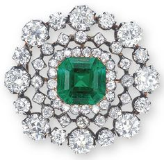 An Emerald and Diamond Brooch (late 19th century) - Centering upon an octogonal-shaped emerald weighing approximately 5.01 carats, within an openwork panel set throughout with old european-cut diamonds, mounted in gold and silver. 3.1 cm long.