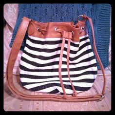 """Drawstring hobo bag Black and white striped canvas drawstring bag with faux leather trim, in excellent condition, interior is lined and includes one zipper pocket and two slip pockets for cell phone, etc. No brand name. L: 13"""" H: 12"""" W: 6.5"""" Bags Hobos"""