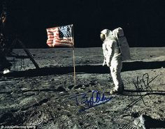 A photograph signed by the Apollo 11 astronauts Buzz Aldrin and Neil Armstrong.