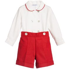 Boys traditional buster suit by Ancar. The cotton blend shirt fastens at the front with two rows of lovely mother-of-pearl buttons, with matching buttons to attach to the shorts at the front, so it will never become untucked. The red piping on the collar matches the fully lined, wool blend shorts, which have smart turn-ups. Size of our little model: Height 93cm, Age 2 Size of suit shown in the photo: 2 yr
