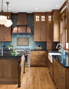 Quarter-sawn oak cabinets, a hammered-copper hood, and a custom tile backsplash add period details with contemporary flair to the new kitchen. Natural Wood Kitchen Cabinets, Hickory Kitchen Cabinets, Light Wood Cabinets, Kitchens With Oak Cabinets, Kitchen Tile Backsplash With Oak, Oak Cabinet Kitchen, Cabinet Stain, Hoosier Cabinet, Kitchen Redo