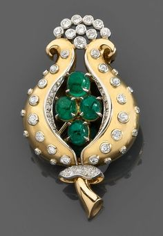 An emerald, diamond, platinum and gold brooch by Rene Boivin, circa 1947.