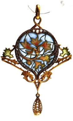 Art Nouveau Masriera Pendant. Beautiful Art Nouveau pendant by jeweller Masriera. Represents vegetal motifs in yellow gold, plique-à-jour enamel, diamonds and pearl. Published and certificated, c 1913