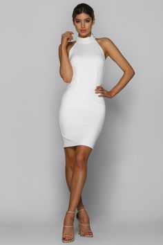 BAD AF FASHION OPULENT DRESS  The Opulent dress is the dress you have been looking for for your occasion. It is made from a bright white stretch fabric and is fully lined. It has a high neck and open back with a beautiful cross design which secures the dress for your comfort. Complete this look with nude heels.  Side waist zip Bra suggestion: bra lift tape, adhesive cups Fabric Composition: 95% Polyester, 5% Spandex Model is wearing size XS and usually wears a 6 AUS / 2 US / 6 UK Model's…