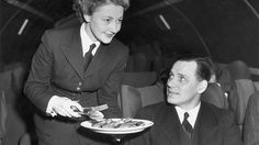 Circa 1956: Air stewardess Joan Piggott serving lunch under the watchful eye of Instructor Matthews in a fuselage 'mock-up'. (Hulton Archive/Getty Images)  - Glamour in the Skies: Vintage Air Travel Photos | The Weather Channel