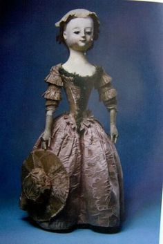 wooden doll holding hat