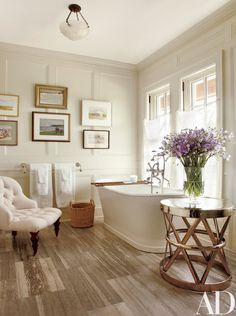"""An easy way to keep humidity at bay: Let some fresh air in. """"Most art can work in your bathroom as long as you can keep steam buildup to a minimum,"""" Miller says. """"So make a habit of using your exhaust fan and keeping the windows open whenever possible, to let your artwork breathe."""" 