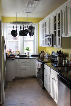 Yellow Walls, White Cabinets. Kitchen ...