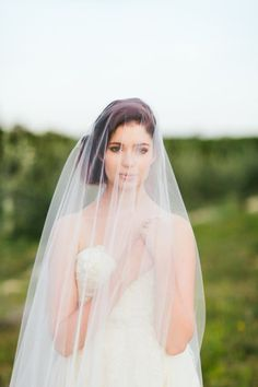 that veil just floats over her. beautiful.