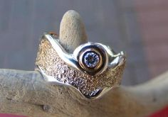 """Eco-Ethical Jewellery Design. """"Riding the waves"""" wedding ring was made using recycled sterling and gold, and reusing client's diamond."""