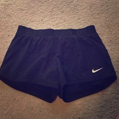 """Nike dri-fit running shorts Black running shorts with attached spandex underneath. """"Just do it"""" around the waistband. Nike Shorts"""