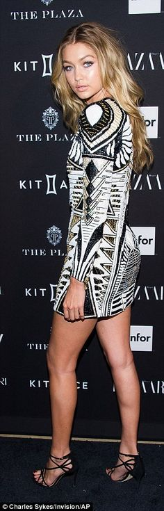 Changing it up: Gigi, who had spent most of the day trotting up and down catwalks, wore on...