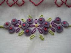 using felt and a french knot to make itty bitty flowrs