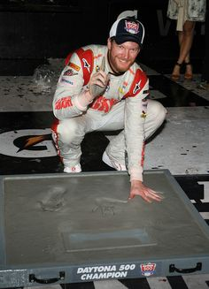Dale Earnhardt Jr., driver of the #88 National Guard Chevrolet, poses after putting his handprints in cement in Victory Lane after winning the NASCAR Sprint Cup Series Daytona 500 at Daytona International Speedway on February 23, 2014 in Daytona Beach, Florida. http://www.pinterest.com/jr88rules/dale-jr-2014/  #DaleJr2014