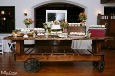 We still love wedding cupcakes!  Especially when they are displayed in such a fun and dynamic way on our rustic farm cart.    venue: willowdaleestate.com photo: billyedonya.com