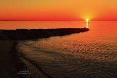 Glowing sunset on Sunken Meadow in Eastham, Cape Cod. Photo by Dapixara.
