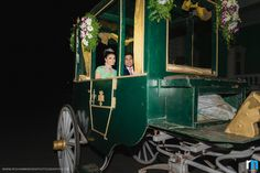 Entering the reception venue in an English carriage decorated with clustered floral arrangement.| weddingz.in | India's Largest Wedding Company | Indian Wedding Unique Ideas |
