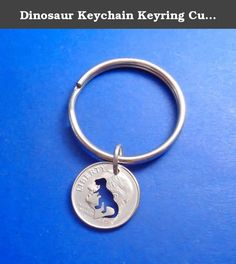 Dinosaur Keychain Keyring Cut In A US Dime. Dinosaur T. Rex keychain cut into a US dime coin. FINISH: All of my coins are completely finished using a multi-step process of burnishing, polishing and cleaning. CONDITION: These are circulated, recycled coins. Although each coin is finished and polished, there may be minor imperfections from having been in circulation. Gift box included. Coin dates may be different from that shown.