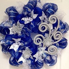 Winter Blizzard Handmade Deco Mesh Wreath with Silver Raz Spray and Snowflakes >>> Check out the image by visiting the link. Blue Christmas Decor, Christmas Mesh Wreaths, Christmas Ornament Crafts, Christmas Table Decorations, Christmas Ideas, Winter Wreaths, Christmas Tree, Holiday Decor, Deco Mesh Pumpkin