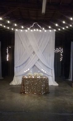 A Sweetheart table fit for Royalty, with stunning draping brought in for the backdrop.