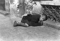 Warsaw, Poland, A boy sleeping on the ground. Taken by the German photographer Willi George in the summer of 1941. The photographs are unique in that they were not staged, but showed the ghetto as it truly was. The boy did not survive