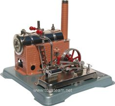 Jensen Steam Engine Model 75 -I actually have one of these, mine is missing the smokestack, I got it as a present when I was about 10 years old. Pop Pup, Toy Steam Engine, Water Fountain Pumps, Stirling Engine, Mechanical Design, Tin Toys, Science Fair, Antique Toys, Engineering