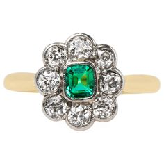 Late Victorian Emerald Diamond Halo Platinum Engagement Ring | From a unique collection of vintage engagement rings at https://www.1stdibs.com/jewelry/rings/engagement-rings/