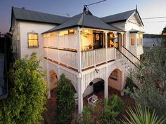Weatherboard queenslander house exterior with balustrades & window awnings - House Facade photo 525953