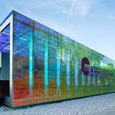 The lovely, recently completed, Carolines-Benimamet Metro Station in Valencia, Spain by Luis Ferrer is made up of a series of colored glass boxes and beautifully designed right down to its platform benches and light fixtures.