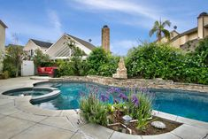 Outdoor fun begins in your sparkling salt water pool w/ledgestone accents & water spills * Plenty of sunny decking awaits & two separate patios for private relaxation.