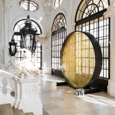 Sun-like+disc+of+8,000+Swarovski+crystals+installed+at+baroque+Viennese+palace