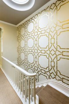 Gorgeous stairway wall by @Caroline Lizarraga Decorative Artist. Image by @Cat Nguyen.