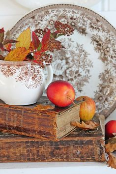 Decorating for fall with old books, apples and brown transferware from VIBEKE DESIGN