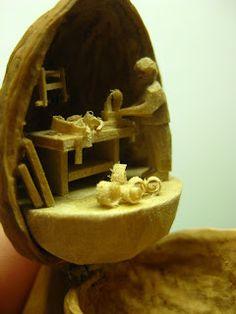 Woodworker scene inside a walnut shell.
