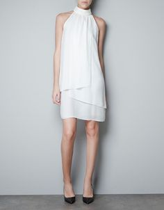 High neck white dress.