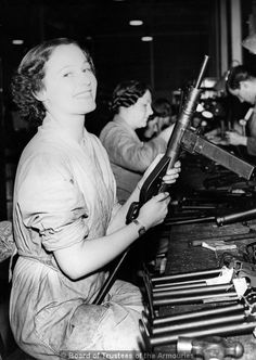 British Sten gun assembly girl; ca. 1942