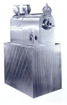 A 1936 Ice Cream Machine! I want a selection of frozen yogurts (only for a summer wedding) and an assortment of our favorite desserts! If I could choose an ice cream maker, I would choose this sweet old bad boy =-) ((Espresso  for winter wedding))