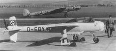The Göppingen Gö 9, with its Dornier Do 17 towing aircraft in the background. Note the tail bumper touching the ground. The Gö 9 was so light, the pilot was needed to get the aircraft to sit on its tricycle landing gear.