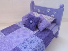 Handmade Doll Bed with Painted Flowers, Mattress and Quilt Set. $80.00, via Etsy.