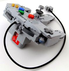 This is an incredible transforming LEGO Nintendo 64 and controller. They are Ultra Hexacon and Tetragon (the game pak minions are Hot-Shot and Mecha Kong). Lego Transformers, Micro Lego, Lego Worlds, Building Systems, Gamers, Lego Models, Brick Building, Super Smash Bros, Nintendo 64
