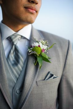 elegant grey and white groom look with striped tie #groom #groomattire #weddingchicks http://www.weddingchicks.com/2014/01/28/creative-canuck-wedding/