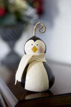 These ornaments are hand painted by Jessie Geesey. The Penguin is approximately 2 and 1/2 inches in diameter and 4 inches tall.
