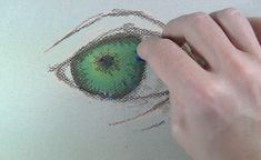 Painting in the darker values of the iris.
