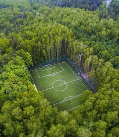 Drone shot of a soccer field in the middle of the woods in Moscow By  crunchcrew