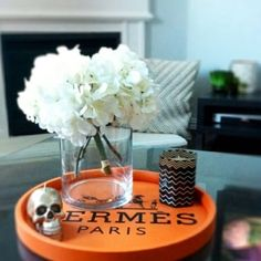 I have an idea to try, use a popcorn can lid, cut a piece of wood so it fits inside the lid, attatch legs and paint the lid, screw the lid on the sides to the wood for a table like this