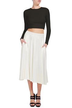 This mid-length skirt is perfect when paired with its matching cropped Cunningham Top for a stroll on the beach.