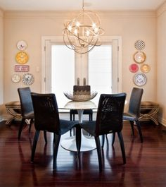 Our Solaris chandelier fits in perfectly with the geometric shapes throughout this dining room.